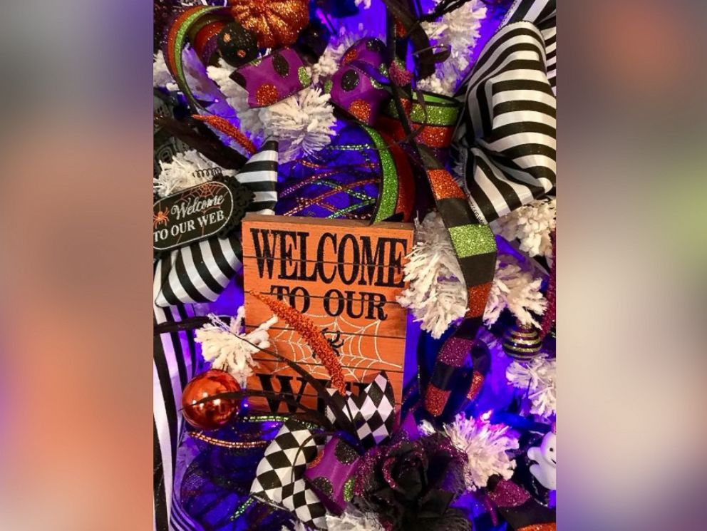 PHOTO: Kandi Jung, owner of Kandis Kreations, decorated a tree with Halloween sayings.
