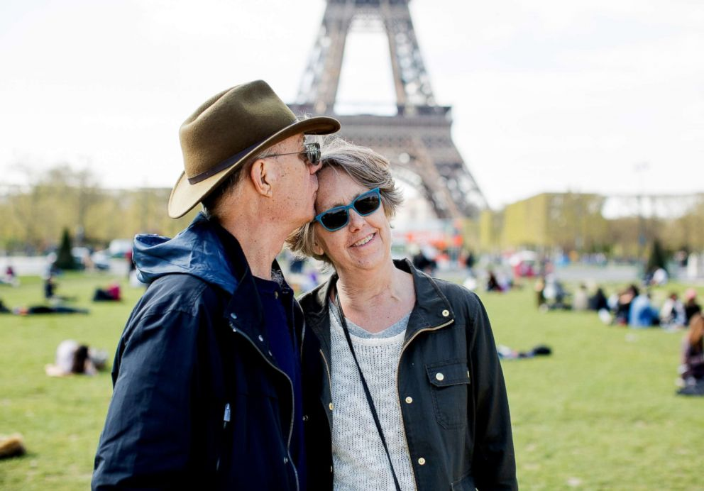 PHOTO: Doug Fuller kisses Sharon Fuller in Paris, April 2016, after her cancer had returned and she was diagnosed as terminal three months prior to the trip.