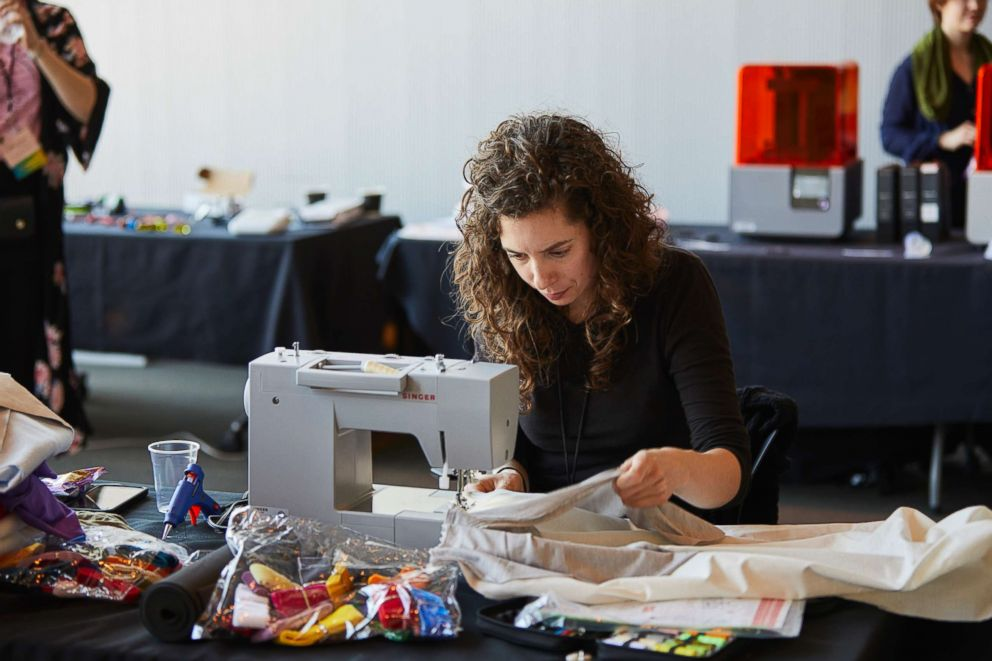 PHOTO: A participant uses the sewing station at the 2018 Make the Breast Pump Not Suck Hackathon at MIT.