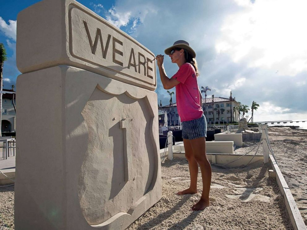 PHOTO: Sand sculptor Marianne van den Broek works on a piece to promote tourism to the Florida Keys after Hurricane Irma on Oct. 9, 2017 in Key West.