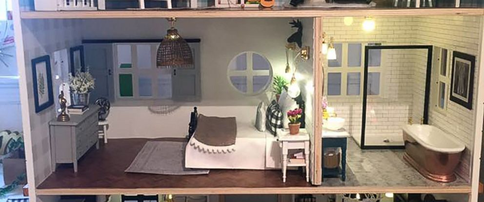 "PHOTO: Kwandaa Roberts hand-painted and built furniture for her ""Fixer Upper"" inspired-dollhouse."