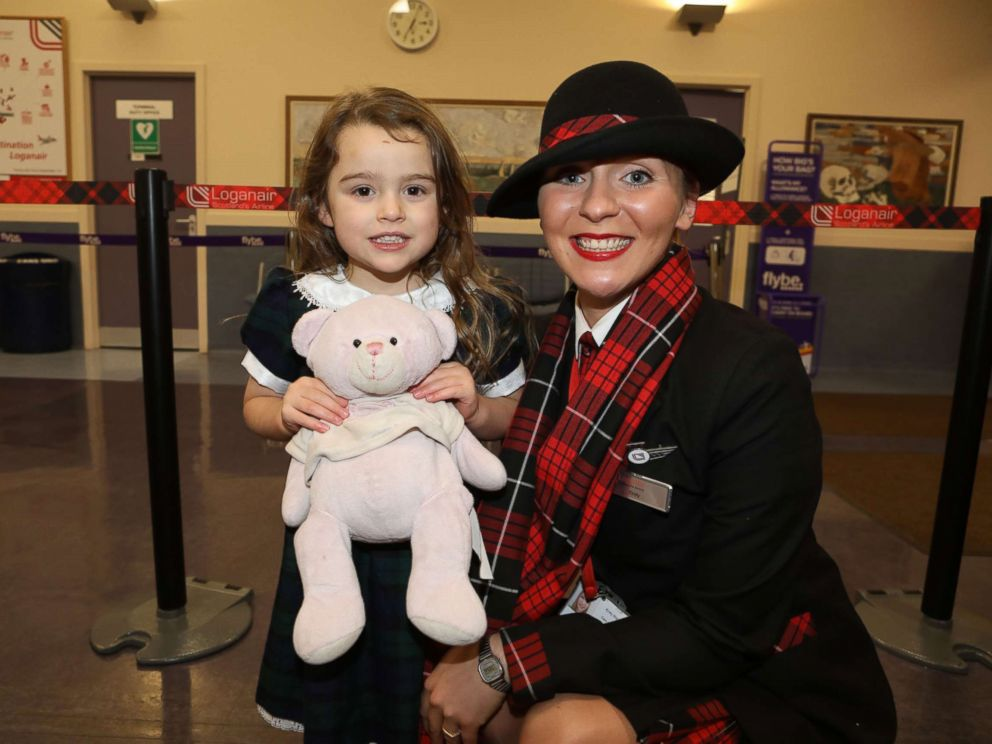 PHOTO: 4-year-old Summer, whose last name was asked to be withheld, with Loganair cabin crew member Kirsty Walter.