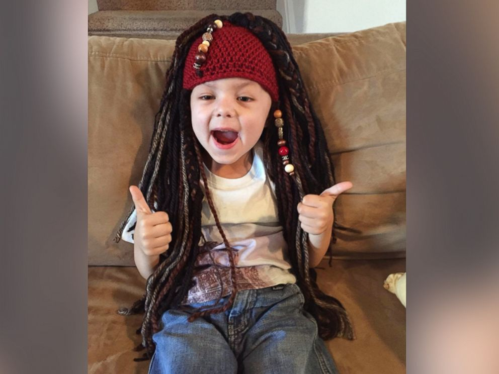 PHOTO: Magic Yarn Project creates homespun wigs for little cancer fighters.