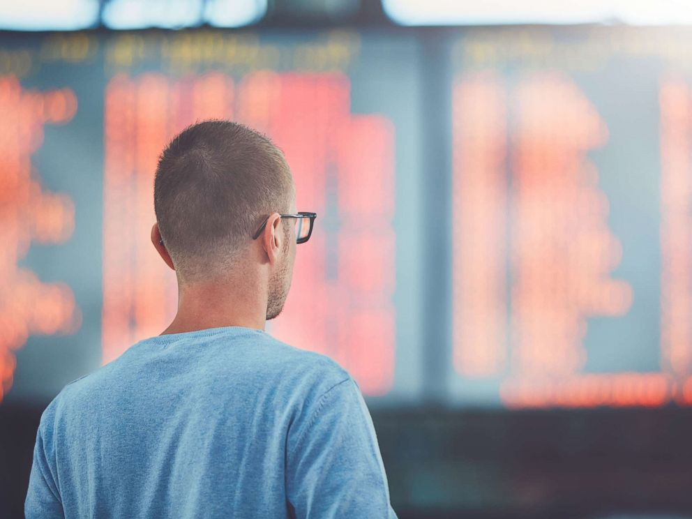 PHOTO: A young traveler watches information about his flight on the departure board at the airport in this undated stock photo.