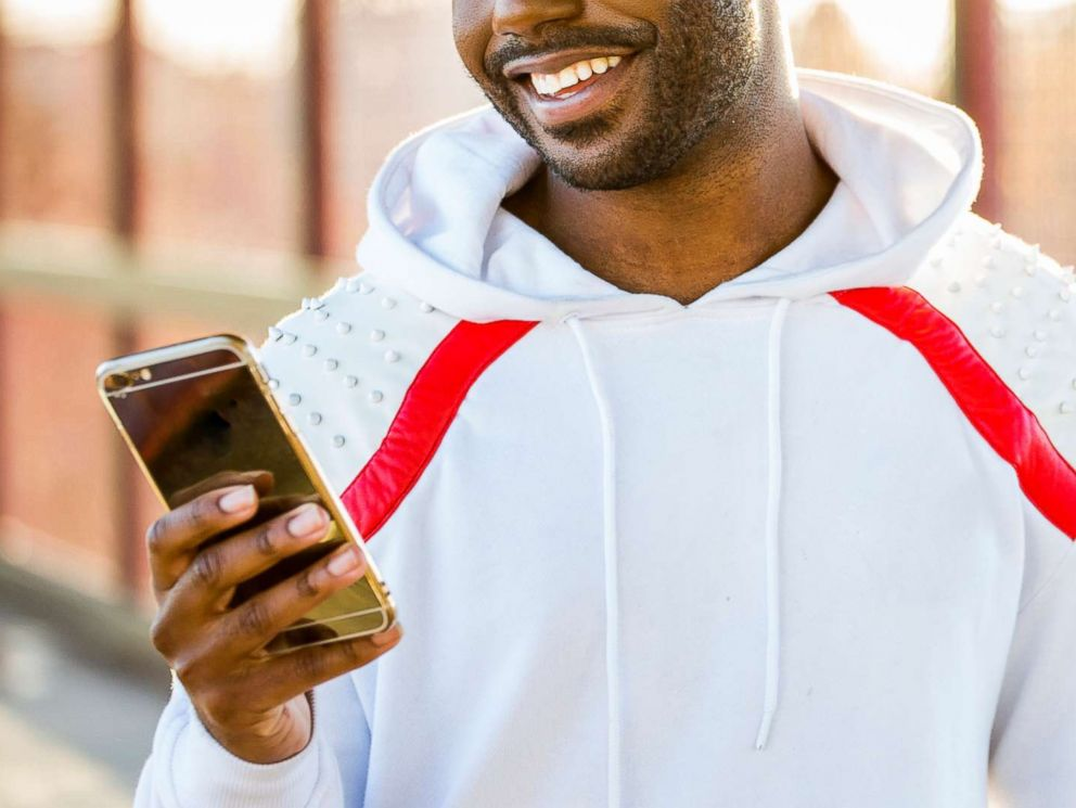 PHOTO: A man smiles as he uses his cell phone in this undated stock photo.