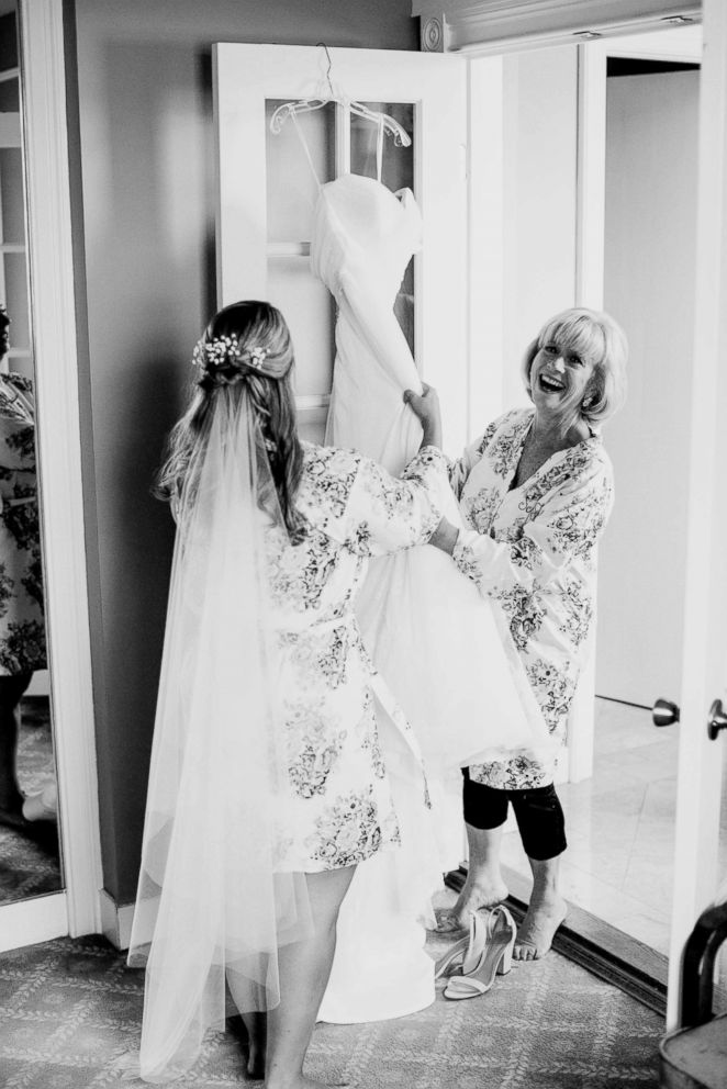 PHOTO: Sarah Marks (bride) and her mother Susan get ready before Sarah's wedding on Sep. 30, 2017, five days after Combe's father died.