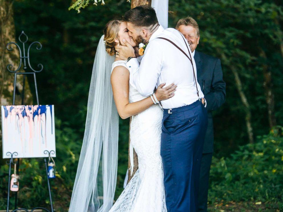 PHOTO: Micah Baker sheds tears of joy as his now wife, Bailey Baker, walks down the aisle at their wedding in Dandridge, Tenn.