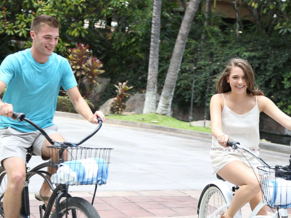 PHOTO: Josh and Michelle bike riding on their date at the Grand Wailea Resort in Maui.