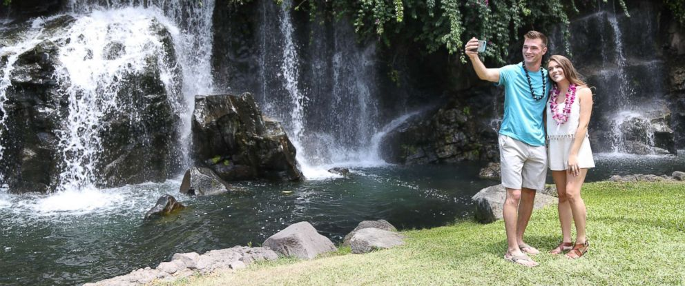 PHOTO: Josh and Michelle snap a selfie on their date in front of a waterfall in Maui.