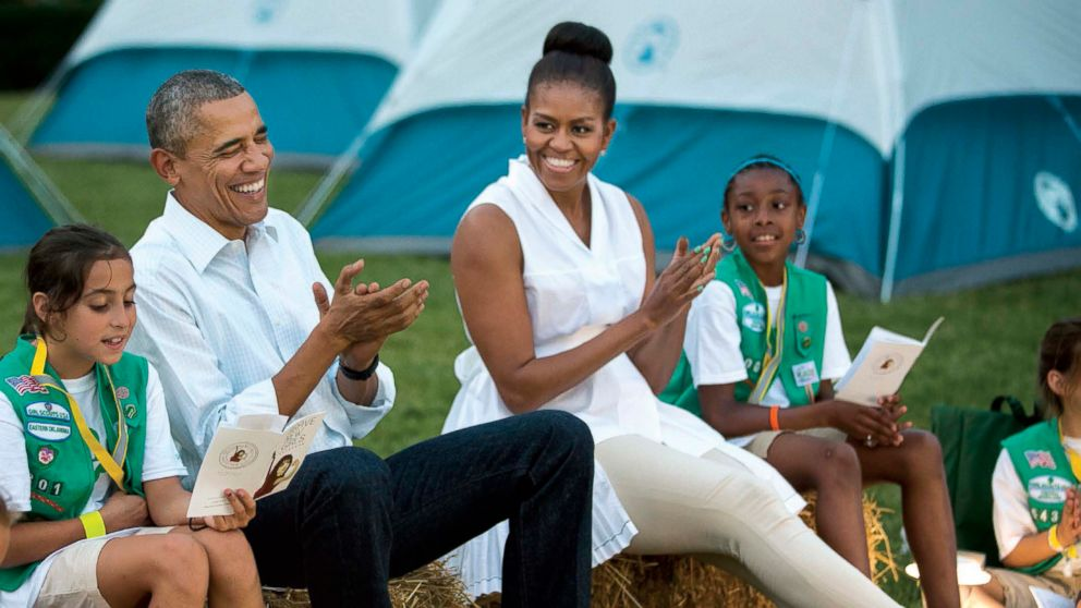 President Barack Obama and First Lady Michele Obama sing songs with Girl Scouts during the White House Campout, on the South Lawn of the White House, June 30, 2015.