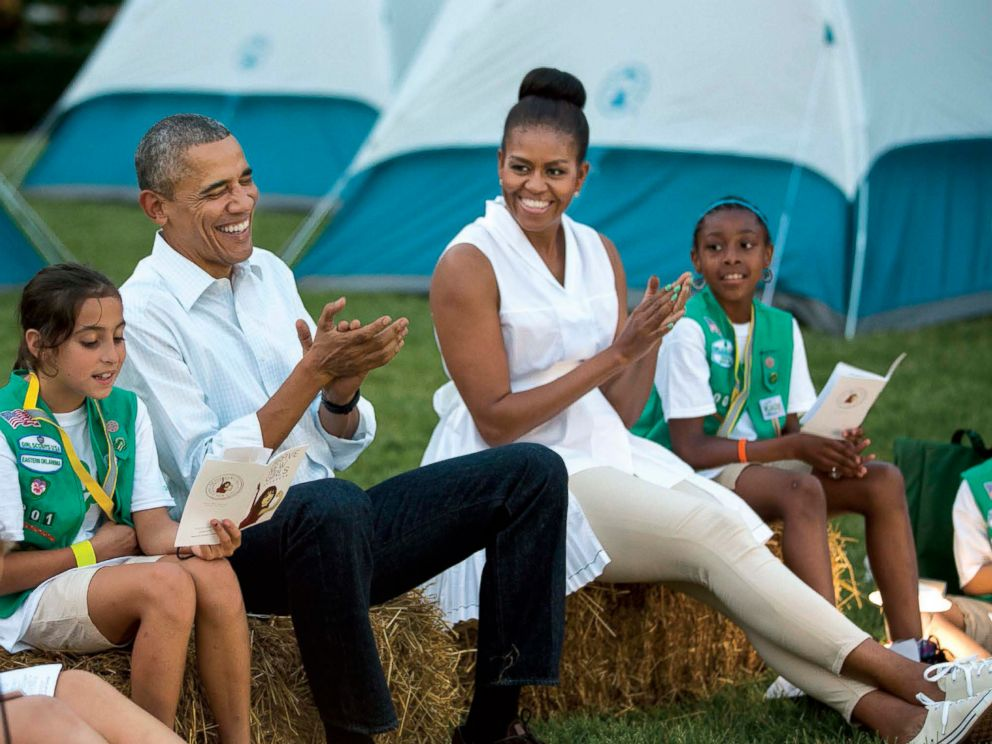 PHOTO: President Barack Obama and First Lady Michele Obama sing songs with Girl Scouts during the White House Campout, on the South Lawn of the White House, June 30, 2015.