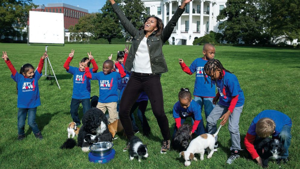 The First Lady participates in an Animal Planet Puppy Bowl filming on the South Lawn of the White House, Oct. 28, 2013.