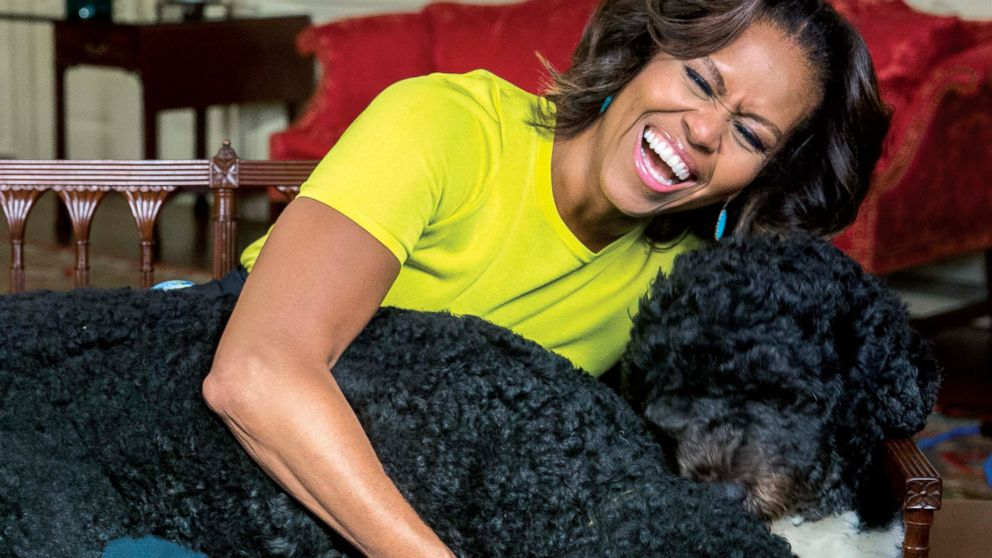 """White House photographer Amanda Lucidon included a candid photo of Michelle Obama laughing with the first dogs in her new book, """"Chasing Light."""""""