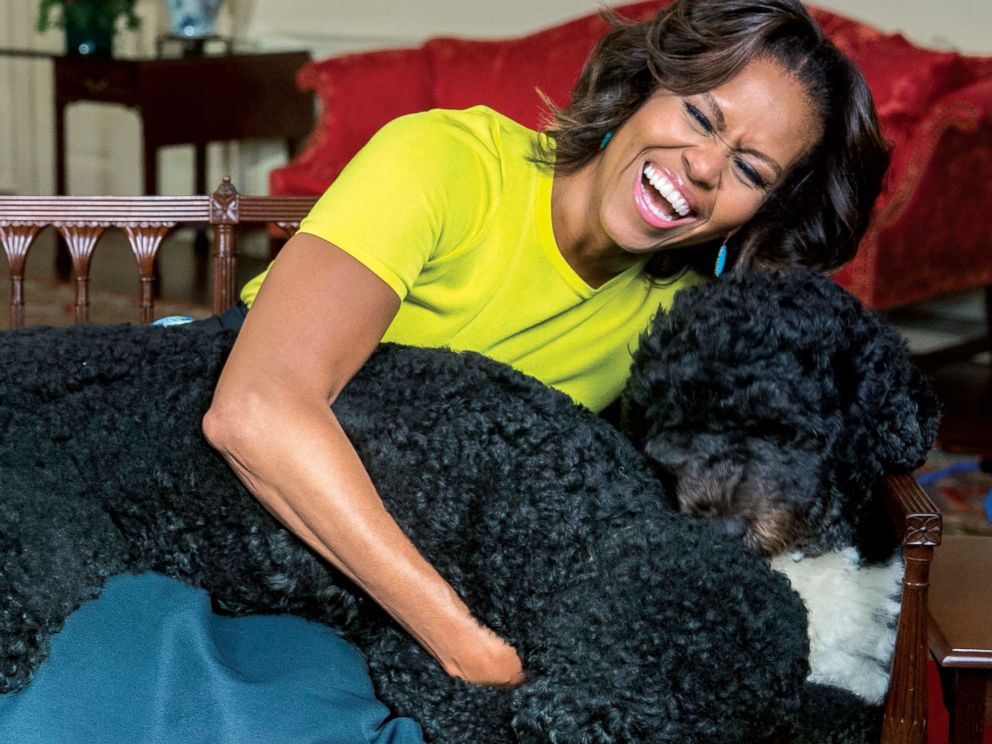 PHOTO: White House photographer Amanda Lucidon included a candid photo of Michelle Obama laughing with the first dogs in her new book, Chasing Light.