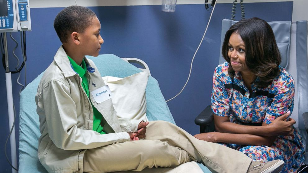 """Michelle Obama visits with Camron Stevens in his room at St. Jude's Children's Research Hospital in Memphis, Tenn., Sept. 17, 2014. White House photographer Amanda Lucidon said, """"It was nice to see the kids light up when Mrs. Obama presented them with Bo and Sunny cookies."""""""