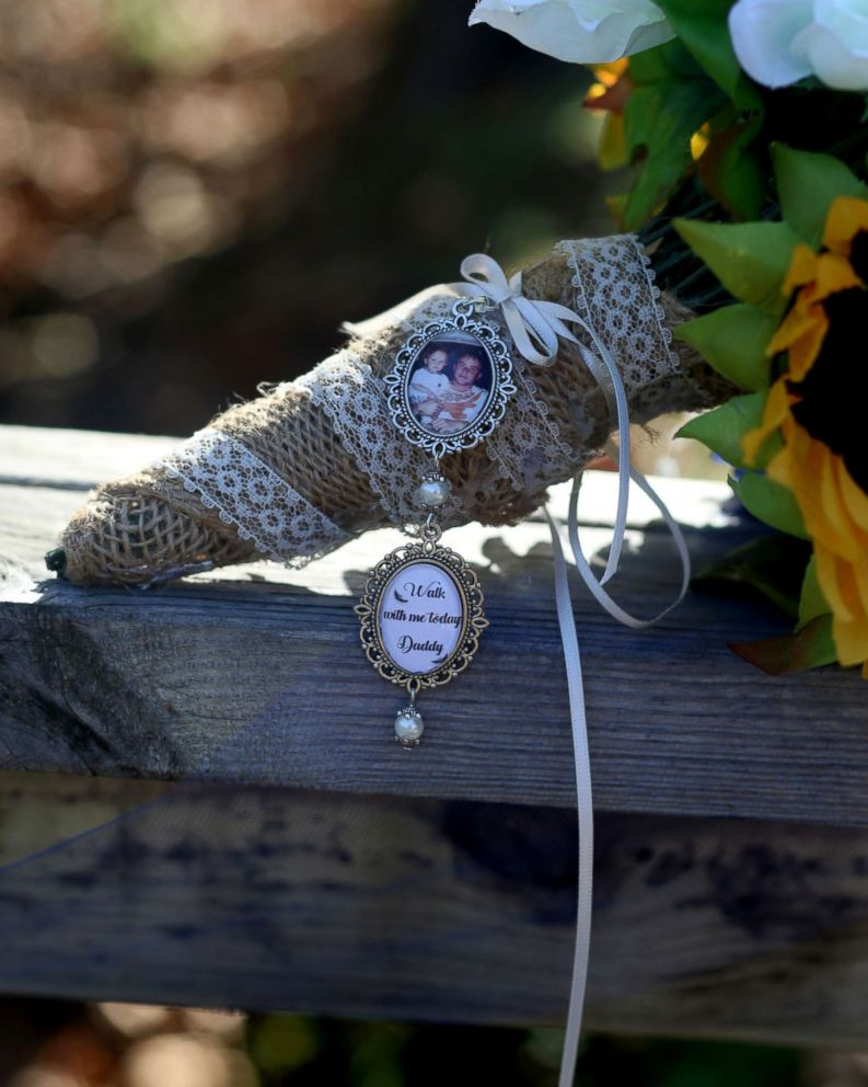 PHOTO: Mikayla Wrotens wedding bouquet included a photo of her late father with the words, Walk with me today Daddy.