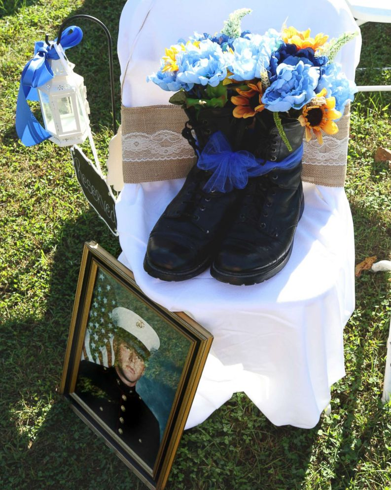 PHOTO: David Polings Marine portrait and boots sat in the seat where he would have been, said the bride.