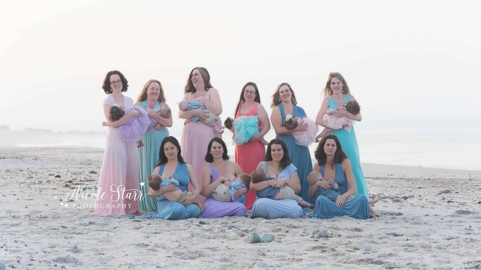 Ten moms of babies with Down syndrome gathered for a breastfeeding photo shoot.