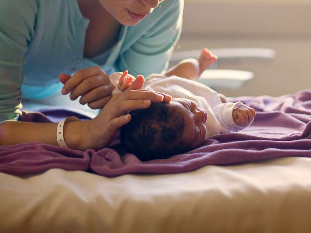 PHOTO: A mother sings to her newborn in this undated stock photo.