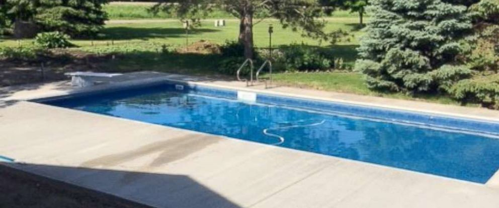PHOTO: Keith Davisons finished pool created by Custom Pools complete with a diving board.