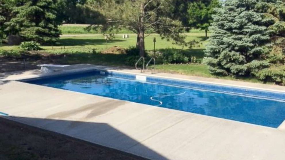 Keith Davison's finished pool created by Custom Pools complete with a diving board.