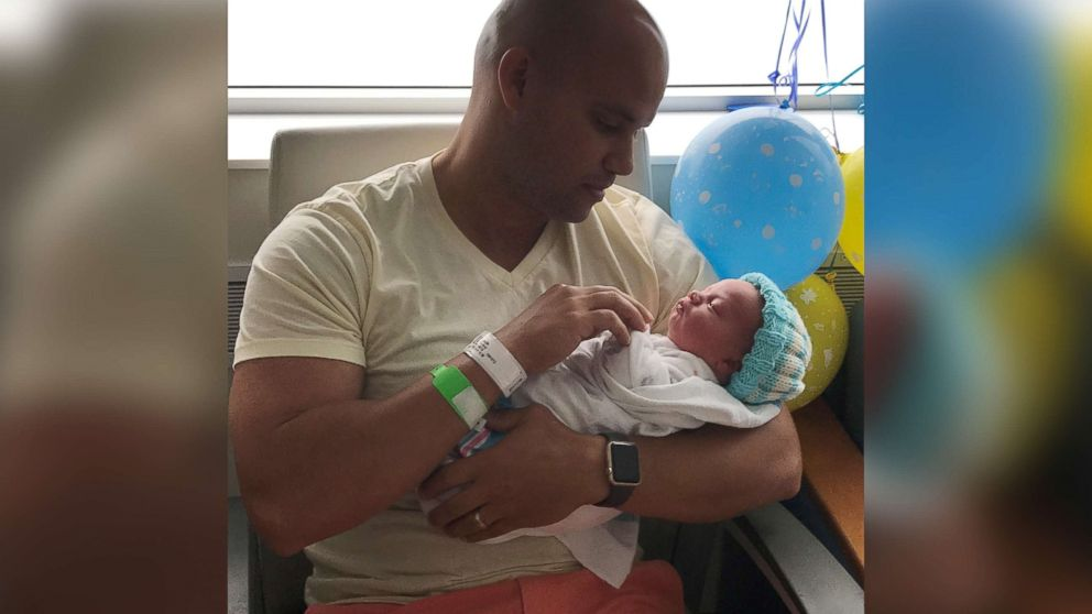 Michael Chuppa holds his newborn son, Blake, born July 10, 2017 at Hillcrest Hospital. Baby Blake is sporting a knit cap created by Barbara Lowe.