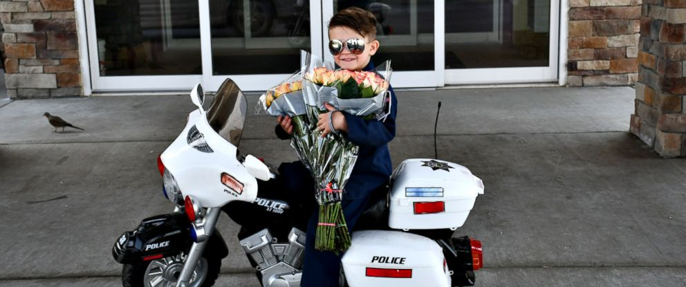 "PHOTO: ""Officer"" Oliver Davis, 6, prepares to pass out roses and violations for ""being too cute"" to the senior residents of Westchester Village of Lenexa nursing home in Kansas."