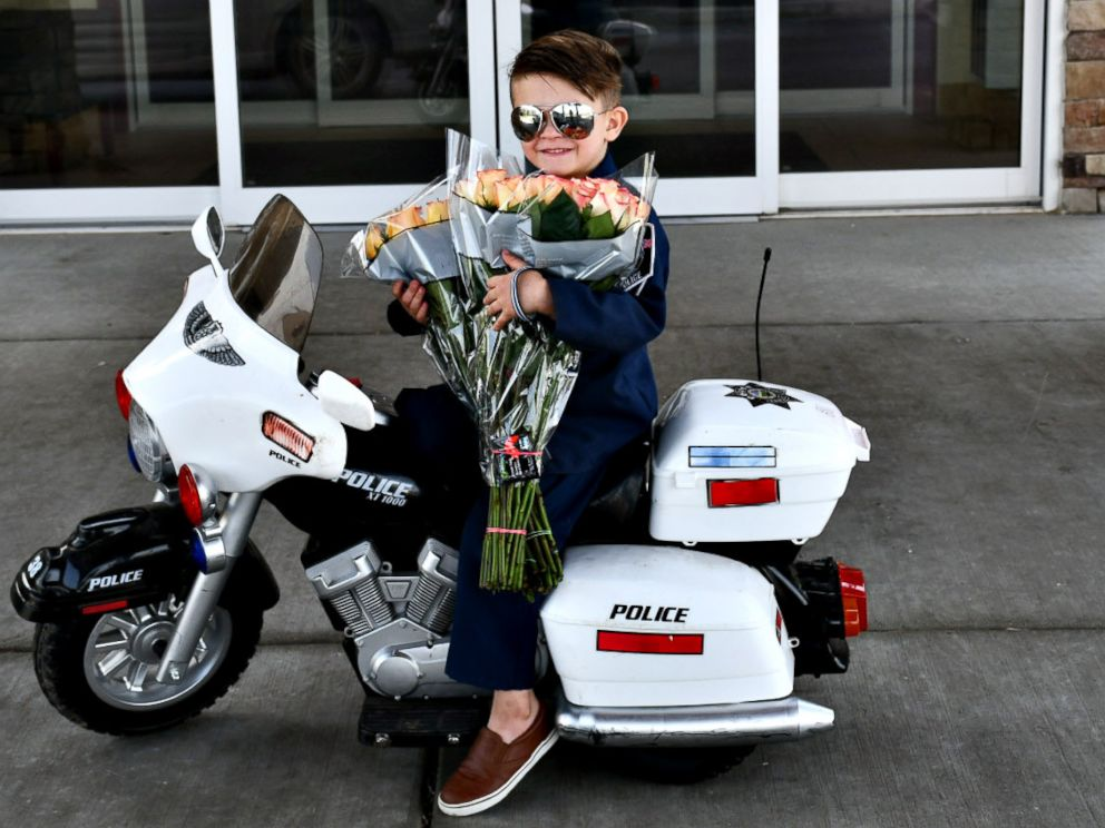 PHOTO: Officer Oliver Davis, 6, prepares to pass out roses and violations for being too cute to the senior residents of Westchester Village of Lenexa nursing home in Kansas.