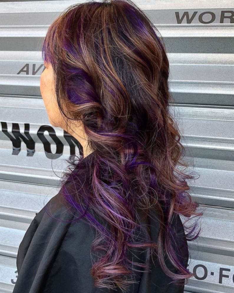 To achieve this look, hair colorists dye their client's hair a purple and caramel color.