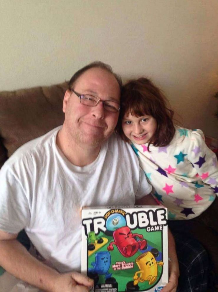 PHOTO: Seen in this undated photo, Philip Pieri, 47, of American Fork, Utah, sits with his daughter, Isabella Pieri, 11.