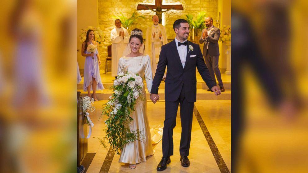 Pilar O'Hara Kassouf and Nick Kassouf walk down the aisle on their Sept. 23, 2017, wedding day.