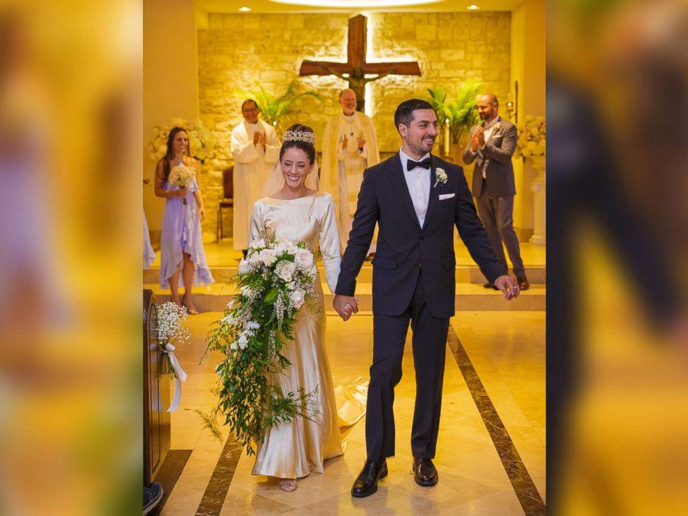 PHOTO: Pilar OHara Kassouf and Nick Kassouf walk down the aisle on their Sept. 23, 2017, wedding day.