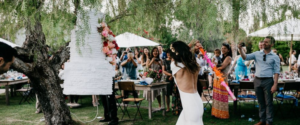 PHOTO: Karen Chan and Clayton Lee wed, May 13, 2017, in Palm Springs, Calif. Instead of a traditional wedding cake, the two had a wedding cake piñata.