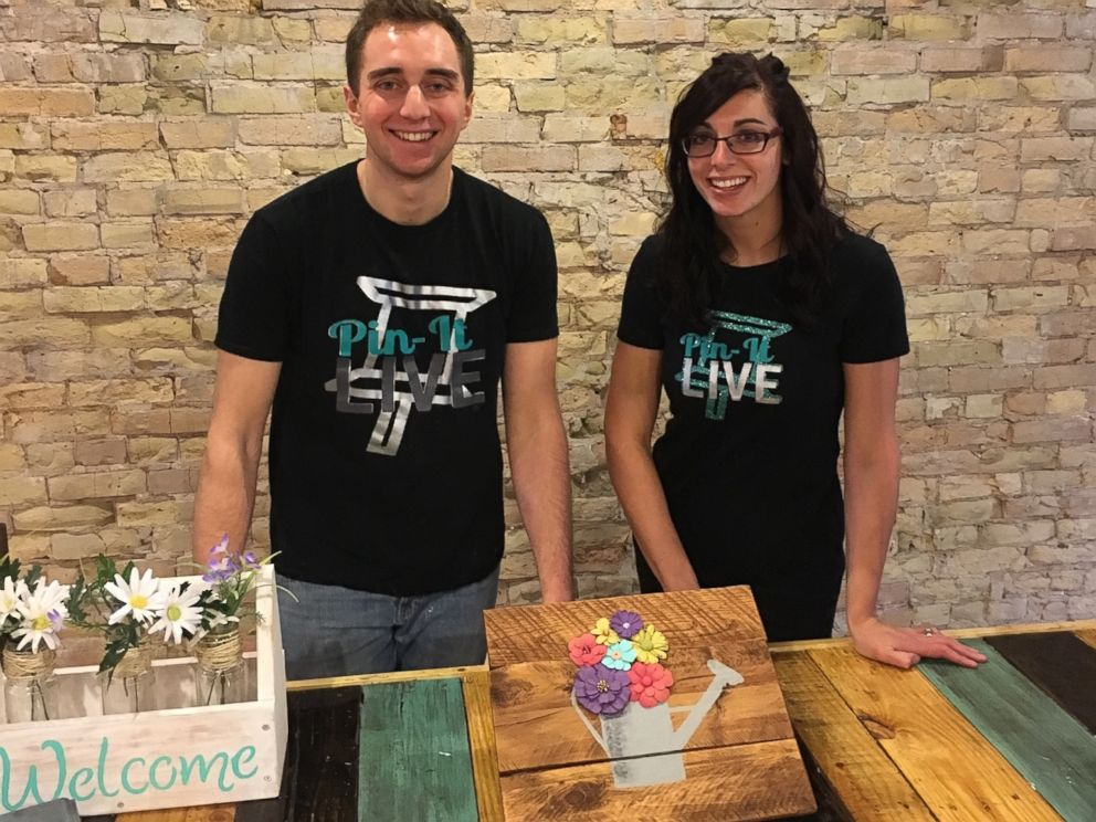 PHOTO: Pin-It Live co-owners Garrett Sheskey and Katie Garcia pose in the Milwaukee studio.