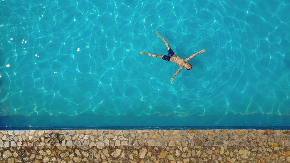 A child swims in a pool in this undated stock photo.