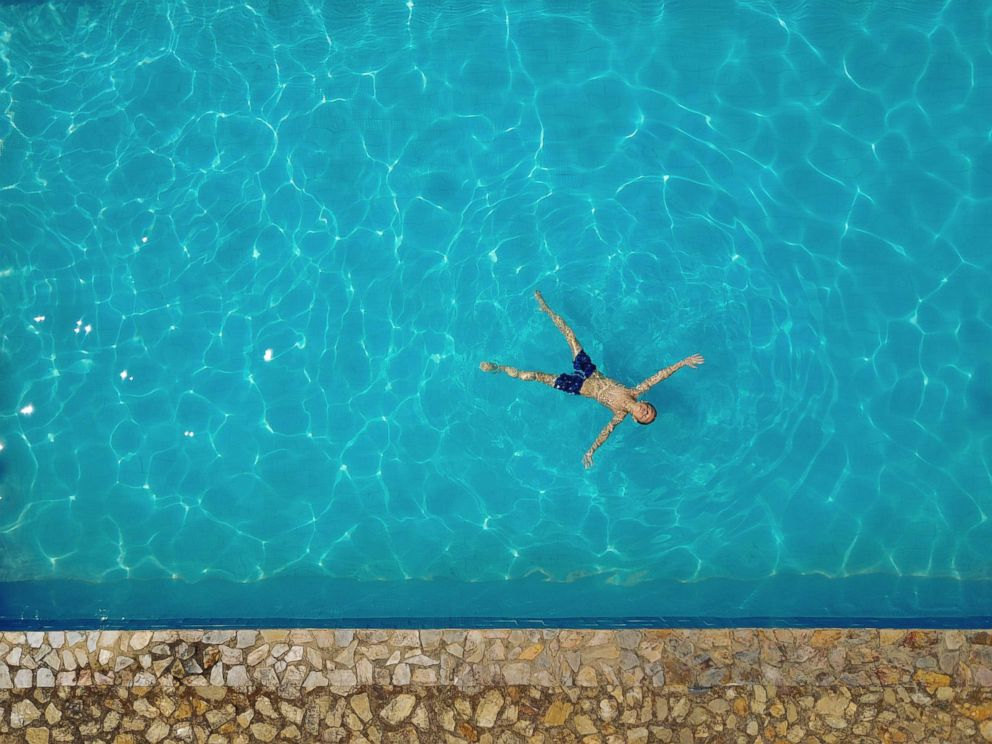 PHOTO: A child swims in a pool in this undated stock photo.