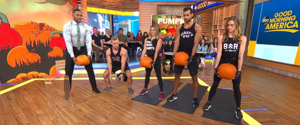 "PHOTO: Good Morning America"" co-anchor Michael Strahan joins trainers from Barrys Bootcamp in a Halloween pumpkin workout."