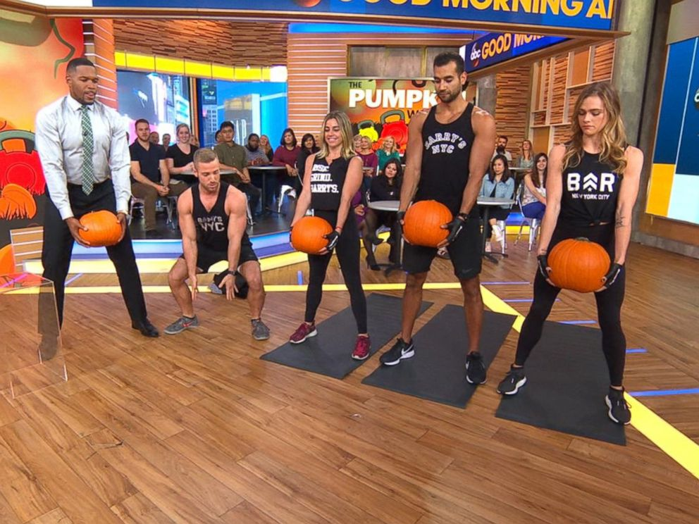 PHOTO: Good Morning America co-anchor Michael Strahan joins trainers from Barrys Bootcamp in a Halloween pumpkin workout.