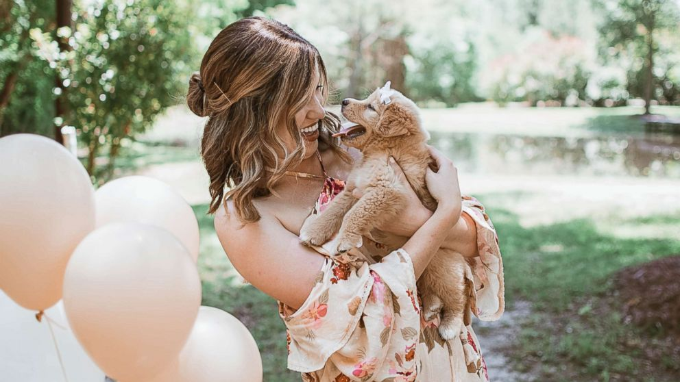 Joy Stone, 25, of Melissa, Texas, was photographed with her new dog, who she named the Rey, in a gender-reveal-style photo shoot in May 2018.