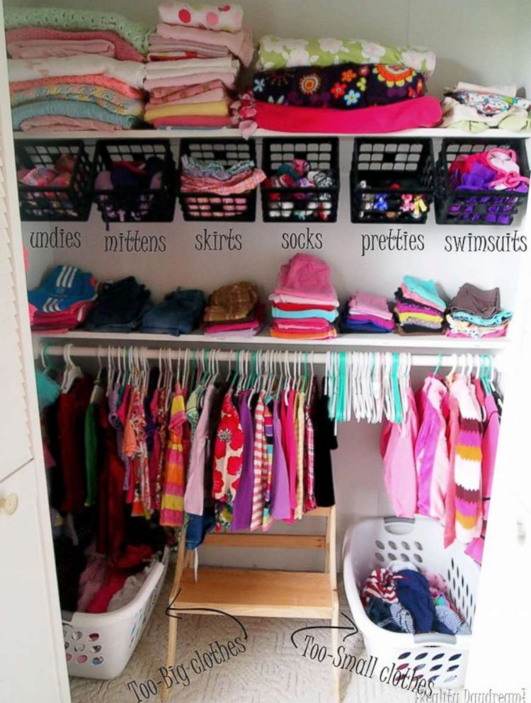 PHOTO: Hooks were installed in this closet under the top shelf where crates were hung for storing socks, swimsuits and more.