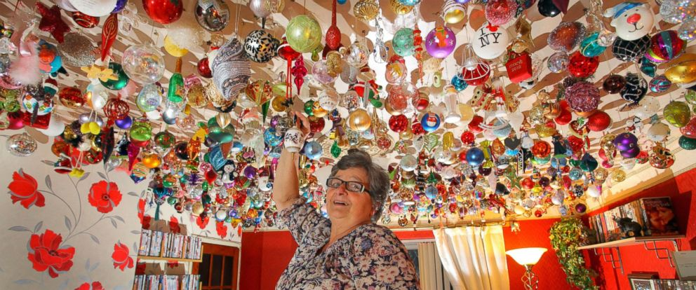 PHOTO: Sylvia Pope, of Swansea, Wales, in her living room with its ceiling covered in 1,750 Christmas ornaments, Nov. 8. 2012.