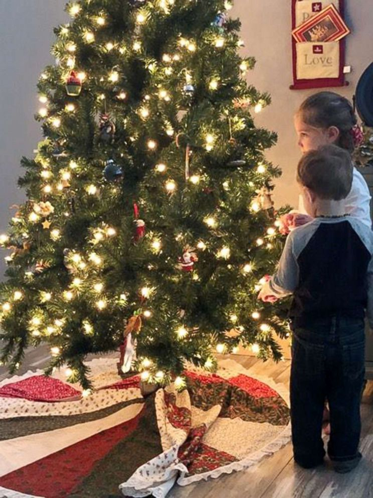 PHOTO: Two of Robinn Graves children look at the Christmas tree that was gifted to them by a woman in New Jersey.