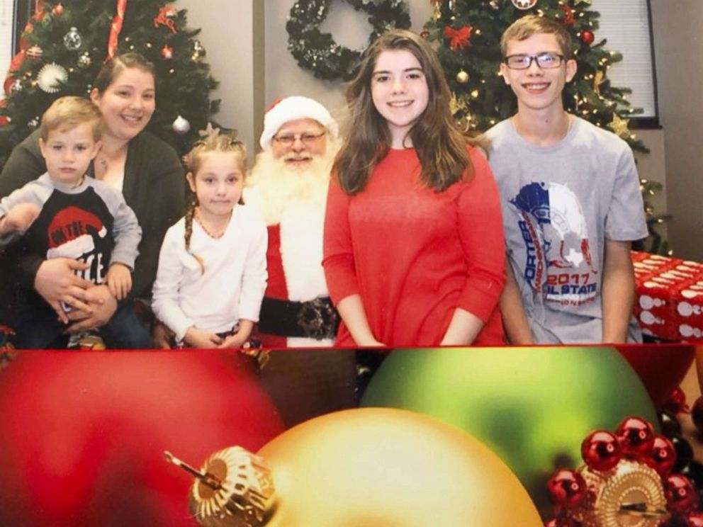PHOTO: Robinn Graves and her children pose with Santa Claus.