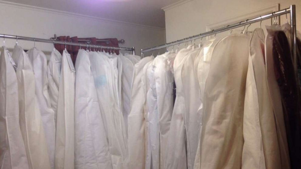 Wedding gowns line the home of Rose Ellis in Tulsa, Okla.