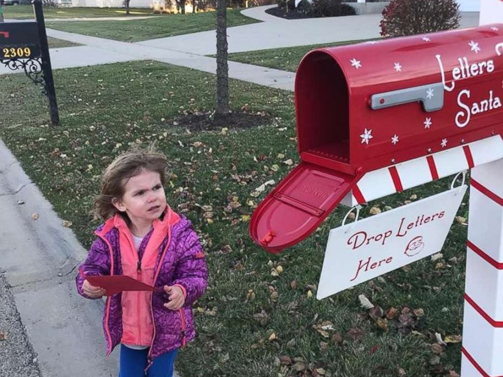 PHOTO: The Calverts neighbor, little Piper Falli, was excited to drop off her letter to Santa.