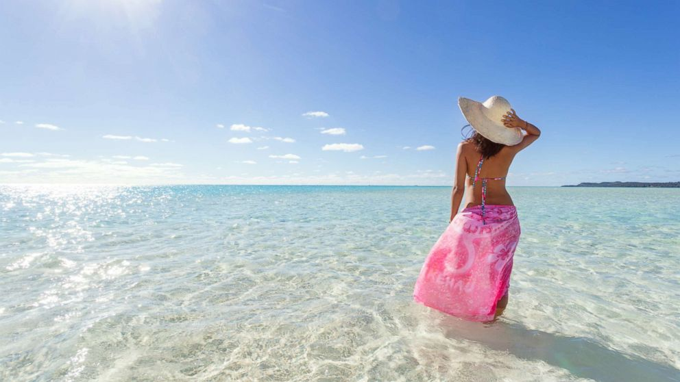 A woman wears a sarong on a beach in an undated stock photo.