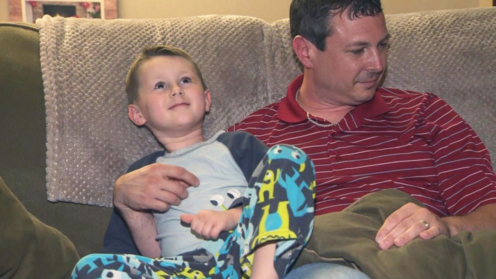 PHOTO: Charlie Aikins of Monroeville, Pa., is seen with his son Carson, 6.