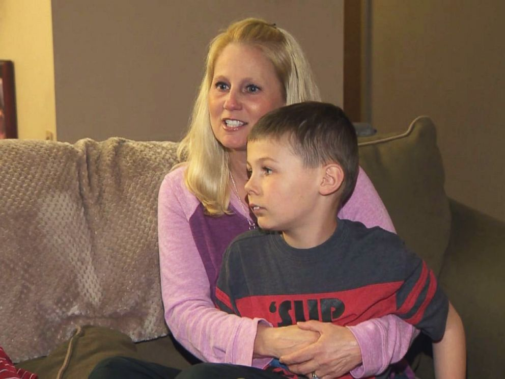 PHOTO: Tammy Aikins, 44, a mother of two from Monroeville, Pa., holds her son, Tyler, 8, during an interview.