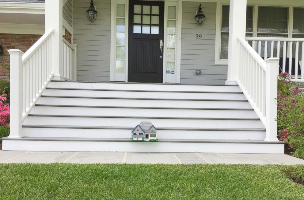 PHOTO: A Lego home built by Shari Austrian sits on the front steps of the actual home.