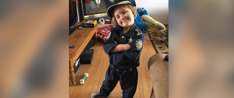 PHOTO: Sidney Fahrenbruch, 4, invited Longmont police officer David Bonday to her new home to check for monsters.